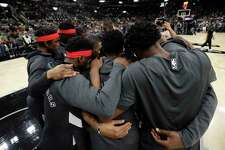 Toronto Raptors players huddle together following a moment of silence for Kobe Bryant before an NBA basketball game against the San Antonio Spurs in San Antonio, Sunday, Jan. 26, 2020.