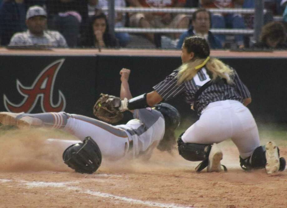 The 2019 softball season was full of electric moments, like Pasadena Memorial tagging out this runner at home plate during the state playoffs. Practices began for the 2020 season this past Friday for all the PISD squads. Photo: Robert Avery