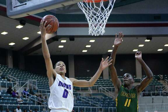 Westley Sellers (0) of Morton Ranch attempts a lay-up during the second half of the Gold Bracket championship game in the Katy Classic Basketball Tournament between the Morton Ranch Mavericks and the Klein Forest Golden Eagles on Saturday, December 7, 2019 at the Leonard Merrell Center in Katy, TX.