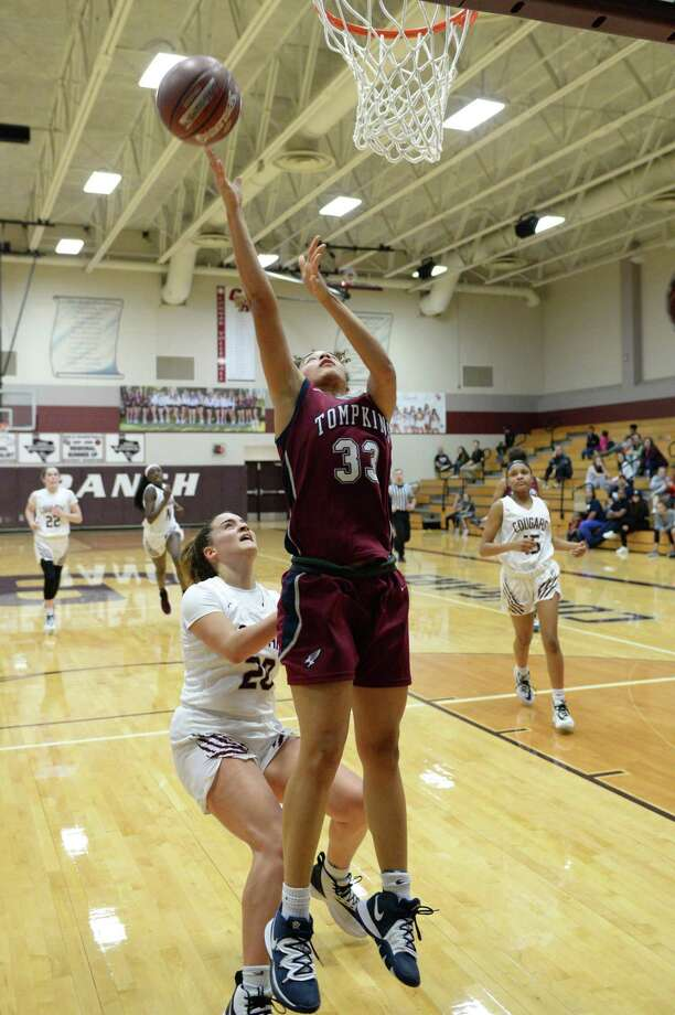 Mia Hill (33) of Tompkins attempts a lay-up during the fourth quarter of a 6A Region III District 19 Girls basketball game between the Cinco Ranch Cougars and the Tompkins Falcons on Friday, January 3, 2020 at Cinco Ranch HS, Katy, TX. Photo: Craig Moseley, Houston Chronicle / Staff Photographer / ©2020 Houston Chronicle