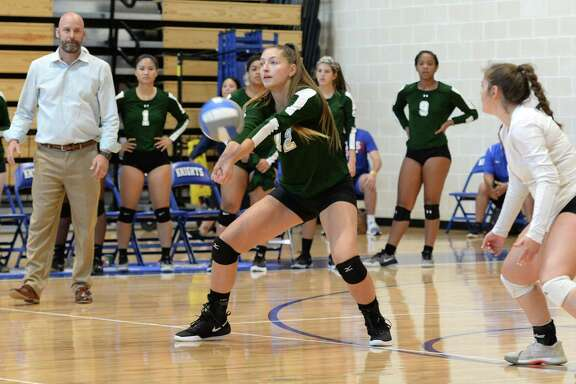 Bailey Hanner (12) of Ft. Bend Christian digs for a ball in the second set of a high school volleyball match between the Ft. Bend Christian Eagles and the Episcopal Knights on August 17, 2018 at Episcopal High School, Bellaire, TX.