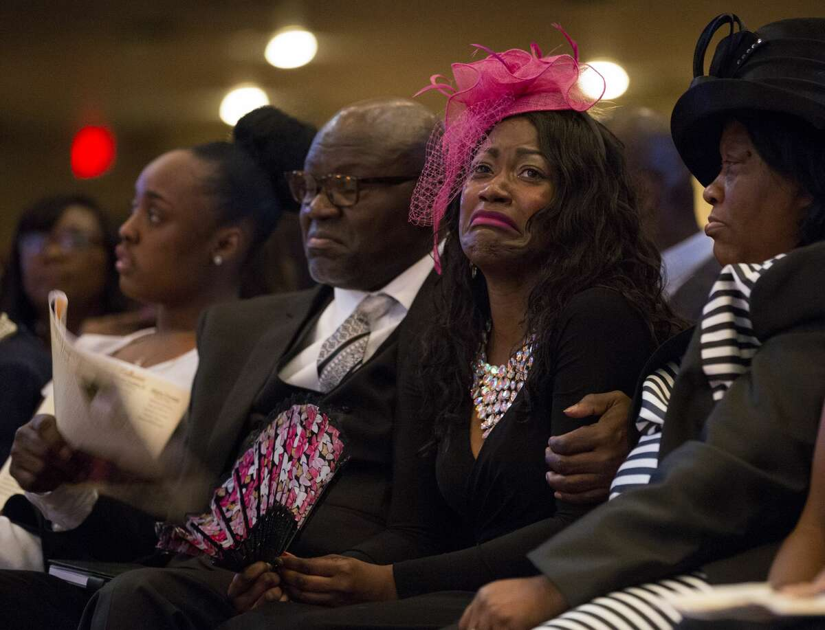 Roxane Freeman, center, grieves the loss of her husband, Heywood, and children, Halynn and Haywood Jr., during the funeral service at the Greater Grace Outreach Church Saturday, July 29, 2017, in Houston.