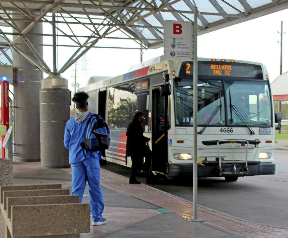 A bus picks up riders at a Houston Metro Park and Ride location near Missouri City. Photo: Kristi Nix