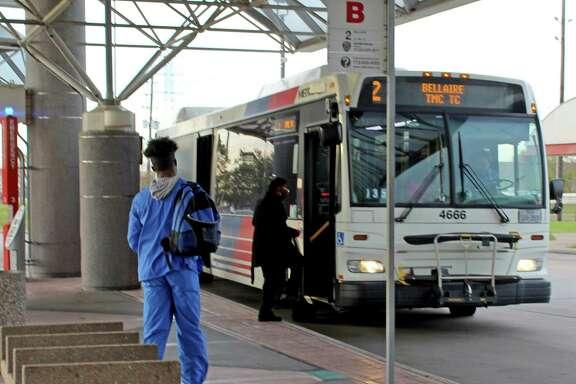 A bus picks up riders at a Houston Metro Park and Ride location near Missouri City.