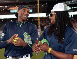 Richard Sherman and Kobe Bryant at a charity softball game.