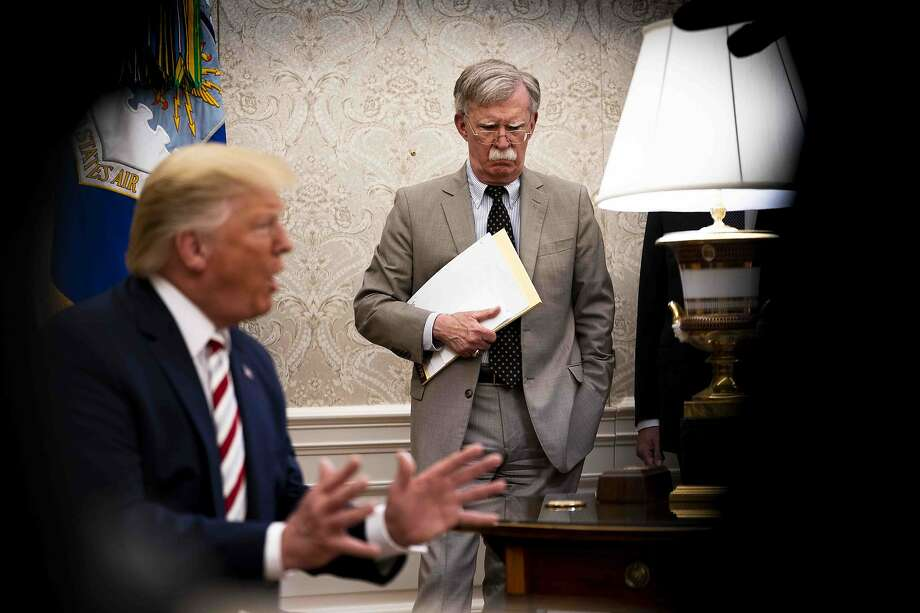 FILE -- John Bolton, then the national security adviser, looks on as President Donald Trump speaks to reporters in the Oval Office on Aug. 20, 2019. A president who has survived one revelation after another the last three years now faces perhaps the most serious disclosure of his political career at the very moment he is on trial in the Senate. (Doug Mills/The New York Times) Photo: DOUG MILLS;Doug Mills / New York Times