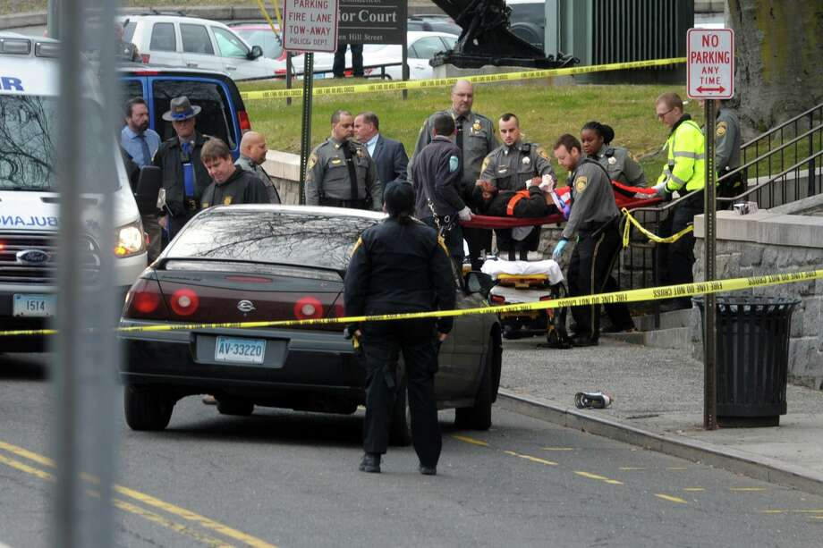 The scene outside the Golden Hill Street courthouse in Bridgeport shortly after four people were shot on Monday. Photo: Ned Gerard / Hearst Connecticut Media / Connecticut Post