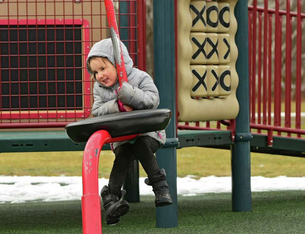 Tuesday will be another great day to play outside. In this photograph, Stella Maietta, 4, of Niskayuna enjoys the playground at The Crossings of Colonie on Monday, Jan. 27, 2020 in Colonie, N.Y. (Lori Van Buren/Times Union)