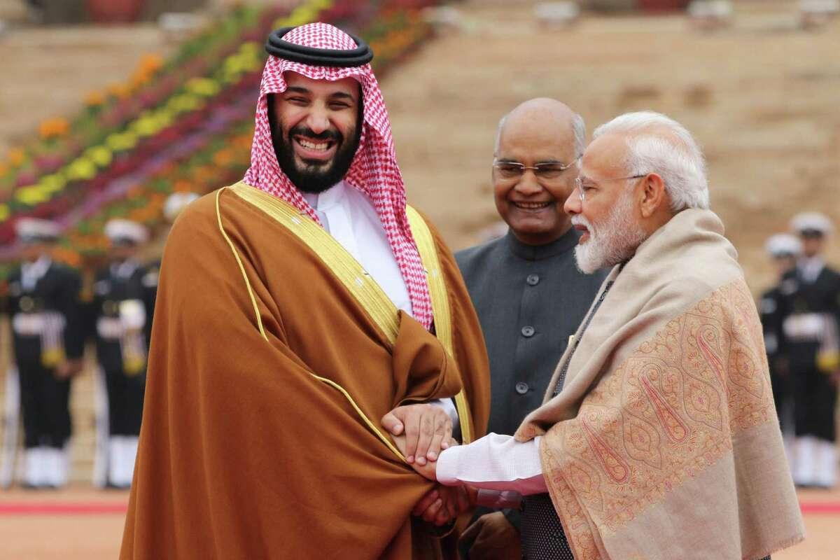Mohammed Bin Salman (left) Saudi Arabia's crown prince, with Indian Prime Minister Narendra Modi (right) and Indian President Ram Nath Kovind in New Delhi on Feb. 20, 2019.