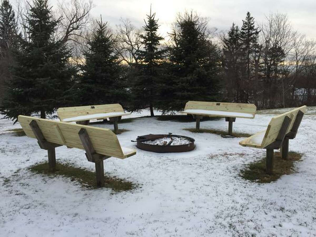 Litchfield Garden Club members, with the help of the community, refurbished the town skating rink last year to include a new seating area with a fire pit, shoe cubbies and other improvements.