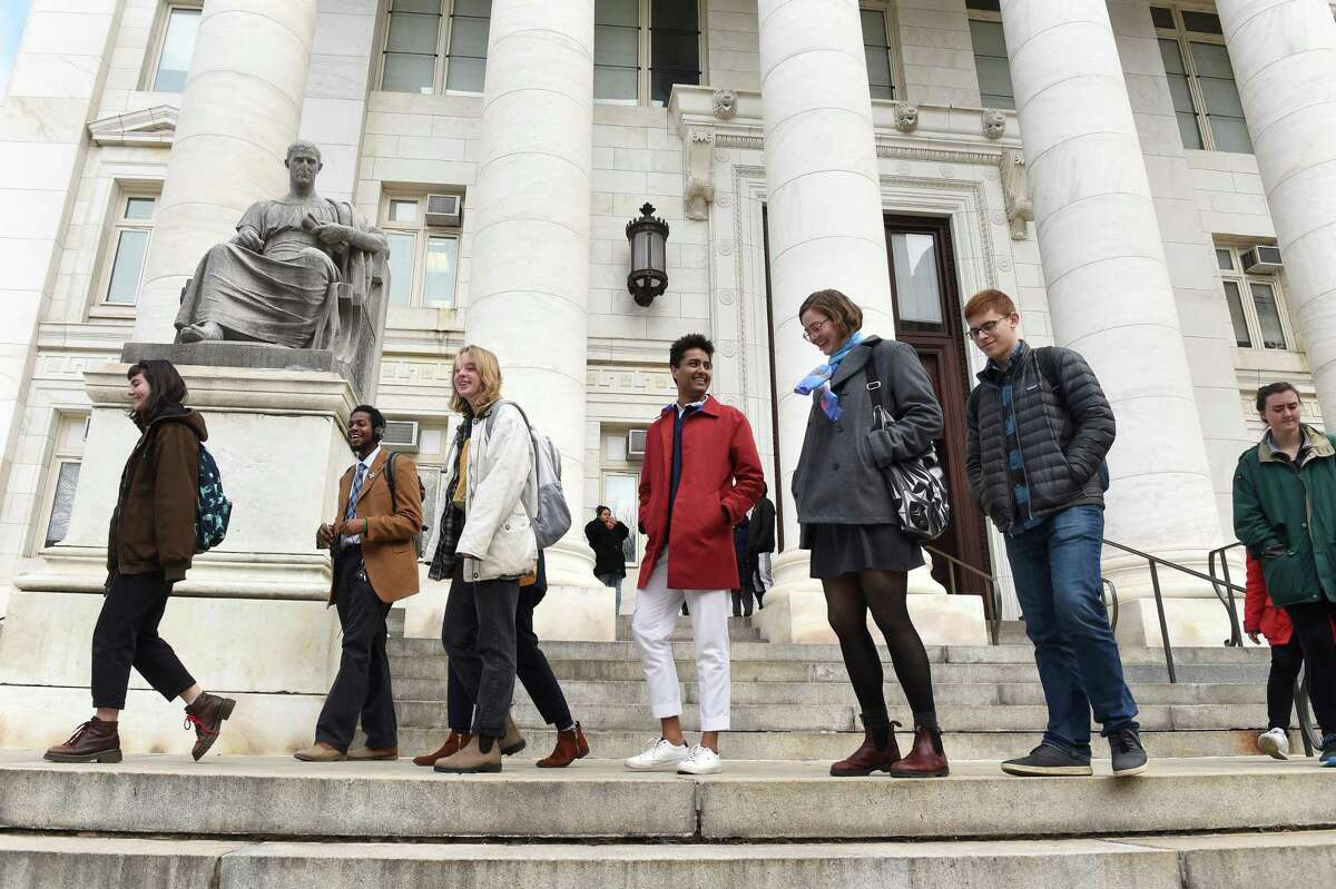 Yale University students leave Superior Court in New Haven Jan. 27, 2020, after a court appearance to dismiss charges from a climate change protest during halftime of the annual Yale/Harvard football game.