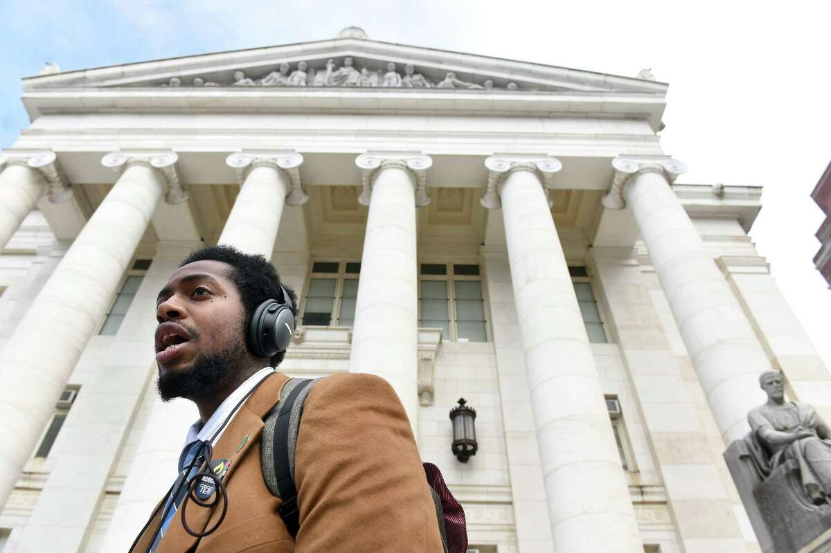 Hamden Councilman Justin Farmer leaves Superior Court in New Haven on Jan. 27, 2020, after a court appearance to dismiss charges from a climate change protest during halftime of the annual Yale/Harvard football game.