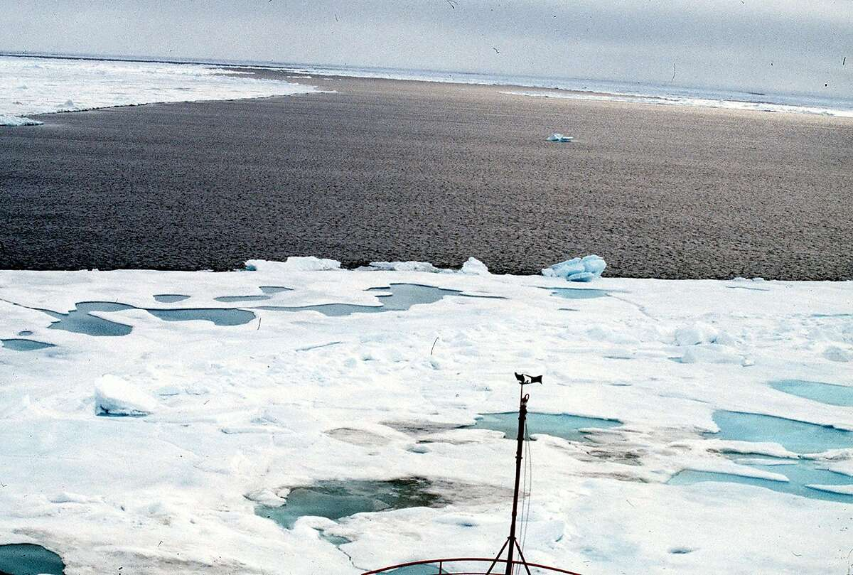 (NYT19) NORTH POLE -- Aug. 18, 2000 -- SCI-NORTH-POLE -- The thick ice that has covered the Artic Ocean at the pole for the last 57 million years or so has turned to water, recent visitors there reported Friday. At least for the time being, an ice-free patch of ocean about a mile wide has opened at the very top of the world. This photo, of opened patch, was taken by Malcolm C. McKenna, a paleontologist at the American Museum of Natural History while aboard a Russian icebreaker which was taking tourists on a polar cruise from Spitsbergen, Norway. (Malcolm C. McKenna/The New York Times) *LITE