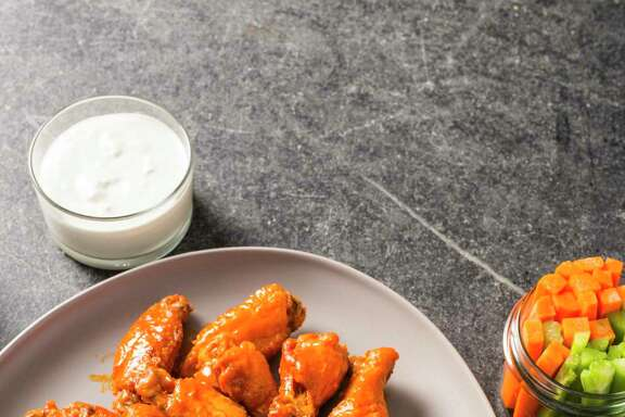 Classic Buffalo wings are coated with cornstarch to ensure a super crispy skin. Fried and tossed in a simple hot sauce, they are the perfect Super Bowl-watch party food.