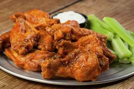 """Pluckers Wing Bar: The company that touts itself as having the """"best wings in Texas"""" is ready for one of its biggest days of the year when wings and football coincide for a perfect storm. The dry and wet flavor choices are huge (ginger peach sriracha, mango-habanero and Dr Pepper are among the more unusual). Pluckers is wings central in Houston with five locations, see pluckers.com. Prices tart at $7.87 for five-piece wings."""