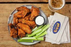"""Pluckers Wing Bar:  The company that touts itself as having the """"best wings in Texas"""" is ready for one of its biggest days of the year when wings and football coincide for a perfect storm. The dry and wet flavor choices are huge (ginger peach sriracha, mango-habanero and Dr Pepper are among the more unusual). Pluckers is wings central in Houston with five locations, see  pluckers.com . Prices tart at $7.87 for five-piece wings."""