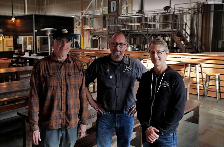 East Brother Beer Co. co-founder Chris Coomber (left) with head brewer Paul Liszewski and co-founder Rob Lightner. The brewery opened in 2017 after Coomber had been homebrewing in his garage for years. Photo: Carlos Avila Gonzalez / The Chronicle