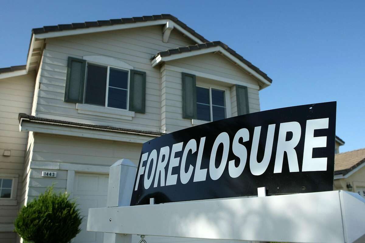 STOCKTON, CA - APRIL 29: A foreclosure sign sits in front of a home for sale April 29, 2008 in Stockton, California. As the nation continues to see widespread home loan foreclosures, Stockton, California led the nation with the highest foreclosure rate. One out of every 30 homes in Stockton is in foreclosure, close to seven times the national average for a metro area in the U.S. (Photo by Justin Sullivan/Getty Images)