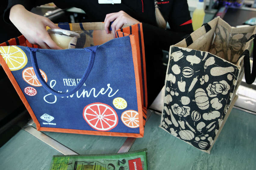 A file photo of a reusable shopping bag. The bags have been popular in municipalities that adopted bans on single-use plastic bags, but now employees of some stores have been told not to touch them due to fears they might carry coronavirus pathogens.