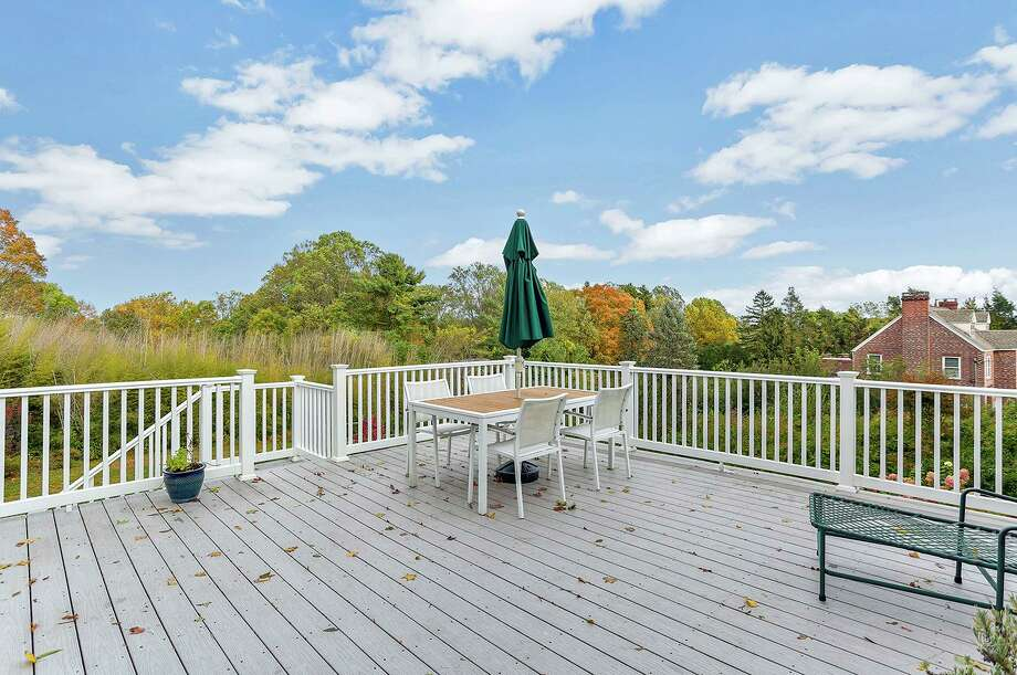 From the breakfast area of the kitchen there is a door to the large raised wood deck that looks over the 1.5-acre level property.