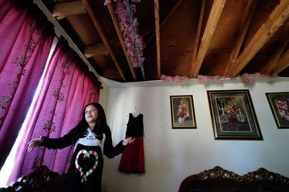 Ximena Lozano, 10, talks in her family's home on Talina Way where the living room ceiling collapsed at the home one street east of Watson Grinding and Manufacturing.