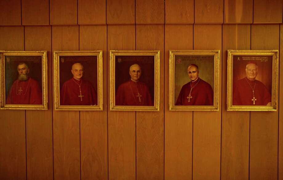 Paintings of former Milwaukee archbishops are seen at the offices of the archdiocese in Saint Francis, Wis. (Darren Hauck for ProPublica) / Darren Hauck