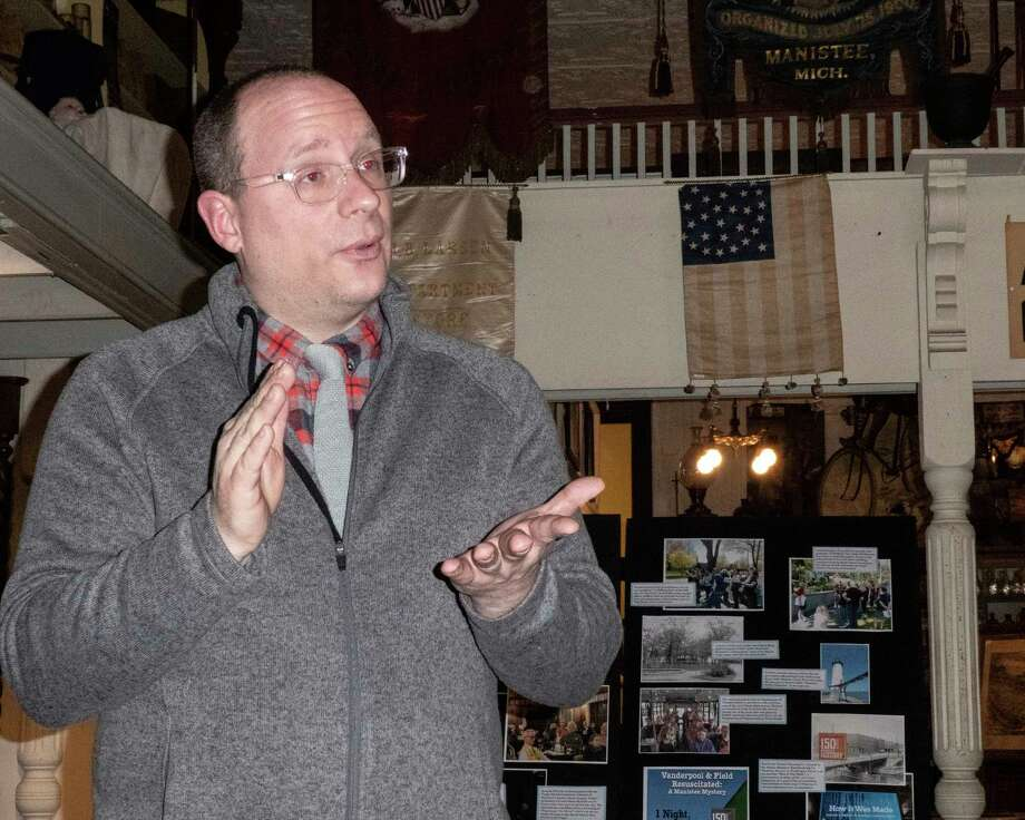 Manistee County Historical Museum executive directorMark Fedder congratulated all the museum's volunteers duringthe annual meeting on Sunday. (Courtesy photo/BobPaetschow)