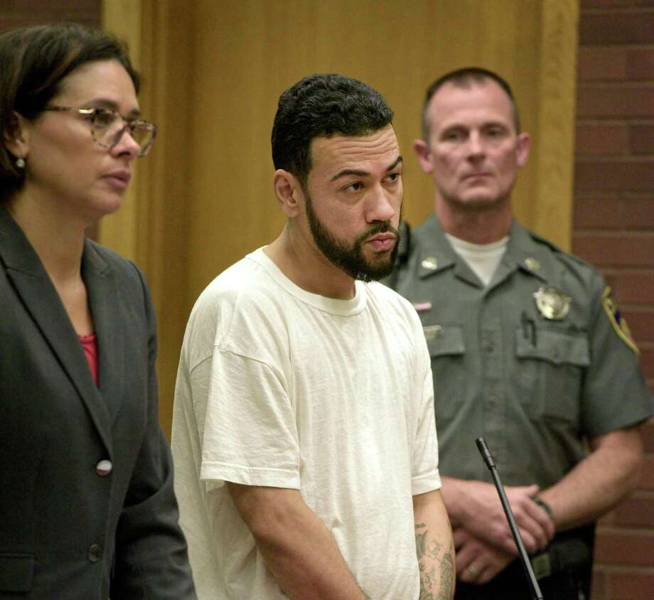 David Ramos in state Superior Court in Danbury alongside his attorney Jennifer Tunnard on Oct. 20, 2019. Photo: H John Voorhees III / Hearst Connecticut Media / The News-Times