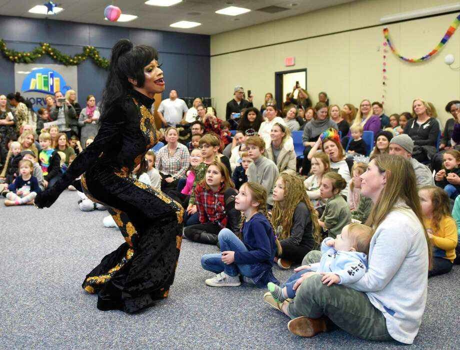 """Drag queen Robin Fierce performs a lip-sync of """"When You Believe"""" at Drag Queen Storytime, presented by Troupe429, at Norwalk Public Library in Norwalk, Conn. Sunday, Jan. 26, 2020. Three drag queens and one drag king read stories to a packed house of children and parents, followed by a lip-sync performance of """"When You Believe."""" A Christian group protested the event outside saying prayers and holding signs including """"defend children's innocence"""" and """"bearded ladies belong in a circus."""" Photo: Tyler Sizemore / Hearst Connecticut Media / Greenwich Time"""