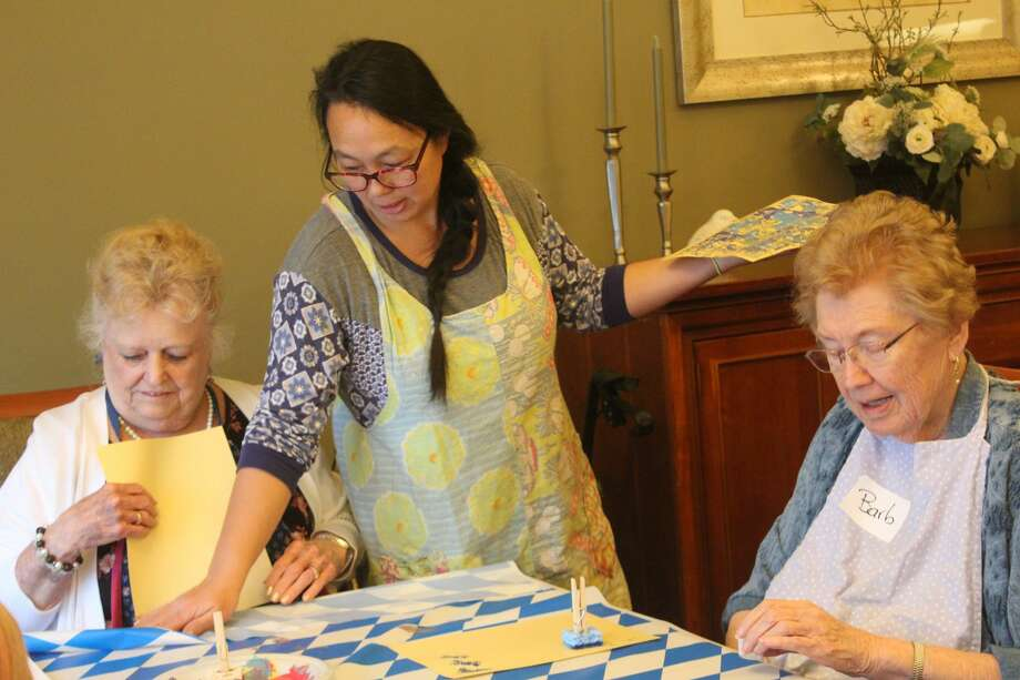 Brookside Elementary School students spent the morning at Evergreen Terrace Assisted Living, working on an art project with the facility's residents. The final project will be displayed in the building at the end of the week. Photo: (Pioneer Photo/Catherine Sweeney)