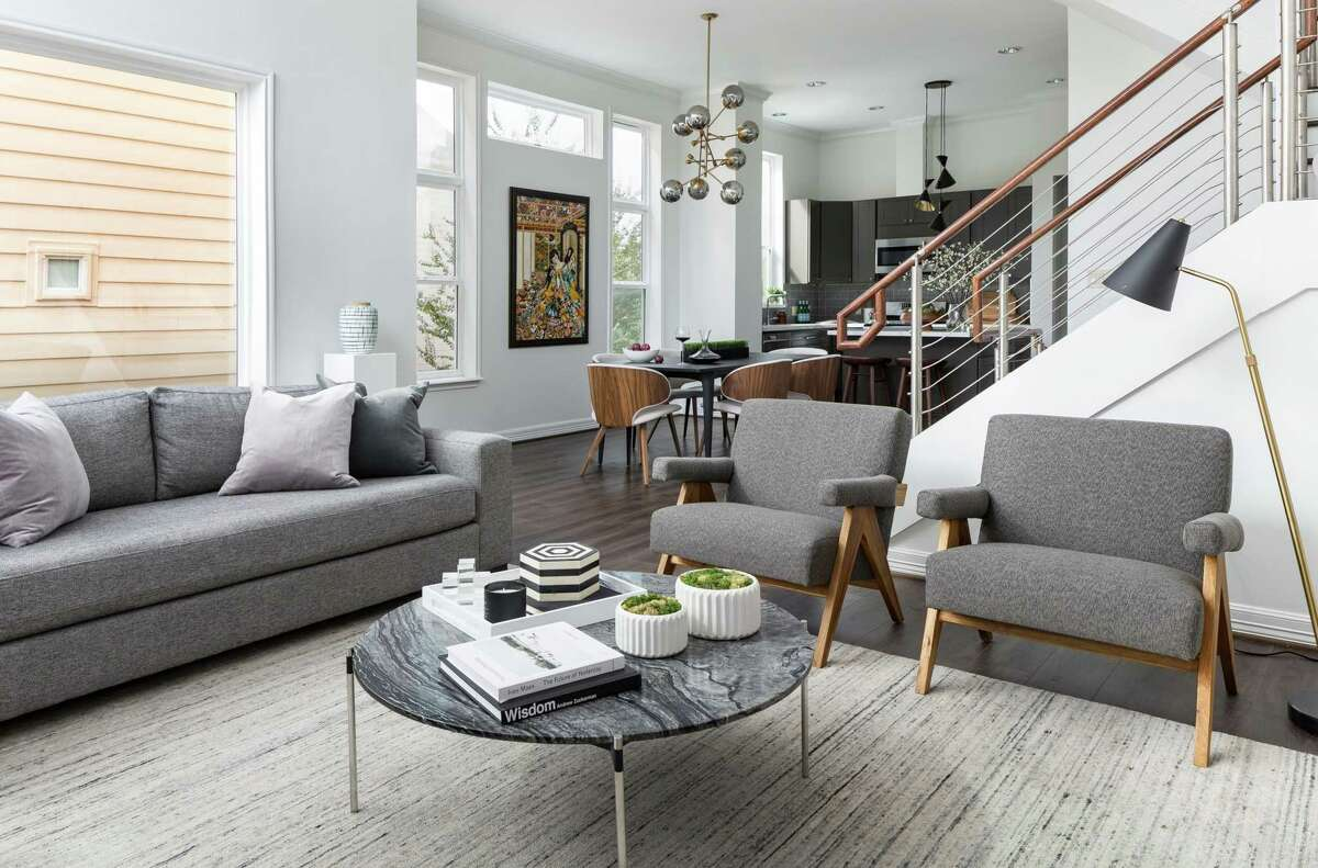 Designer Lacey Michalek combined shades of gray in the Midtown home of Paul and Alice Schrynemeeckers.