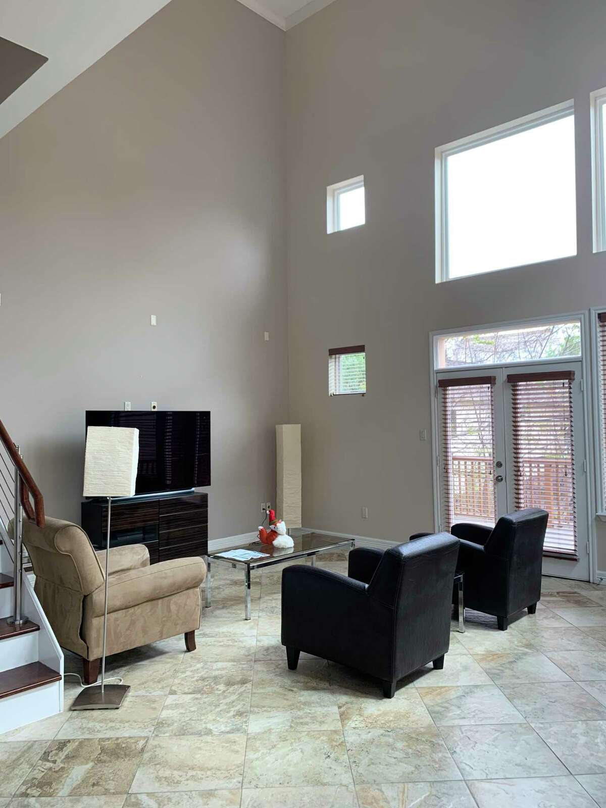 Before: The home was full of earth tones and had the furniture that Paul owned when he was single.