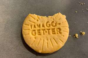 One of the new Lemon-Ups flavor Girl Scout Cookies (with one bite removed).