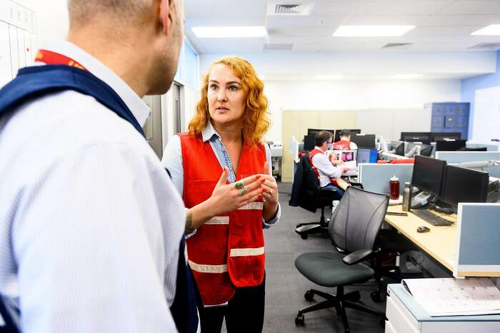 Emergency planner Kay Vasilyeva speaks with Acting Director of Emergency Services Bijan Karimi at the San Francisco Department of Emergency Management's Emergency Operations Center on Monday, Jan. 27, 2020, in San Francisco. Officials activated the center to monitor and respond to coronavirus threats.