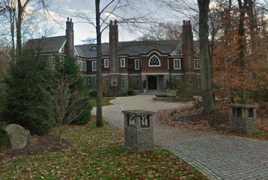 A home at 119 Proprietors Crossing in New Canaan, Connecticut sells for $3,995,000. Photo: Google Street View