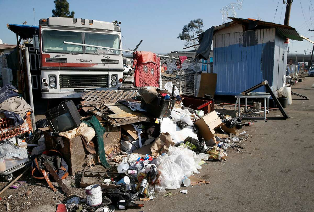 Some trash and debris remains at a homeless encampment in front of the Home Depot near High Street in Oakland, Calif. on Tuesday, Nov. 5, 2019. Oakland officials have recently cleared out about 250 tons of debris from the site but another 50 tons remain.