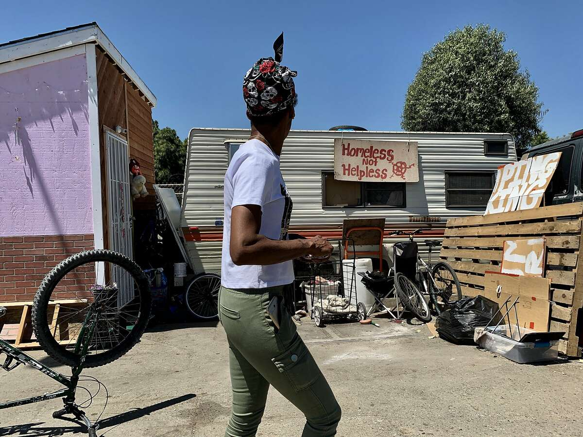 """Markaya Spikes, 38, site leader for the Community of Grace, looks at a RV in the neighborhood near a Home Depot in Oakland, Calif., on Tuesday, June 4, 2019. The Home Depot, located at 4000 Alameda Ave., may pull out of its Oakland store unless the city can curb the crime, tent and RV encampments that have overtaken the area. """"That's the message we got at a meeting with Home Depot representatives,"""" said Oakland City Councilman Noel Gallo, whose district includes the big box hardware store at 4000 Alameda Ave."""