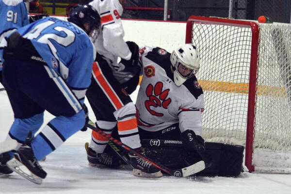 EHS goalie Jonas Akeman makes the save during a game in the regular season.