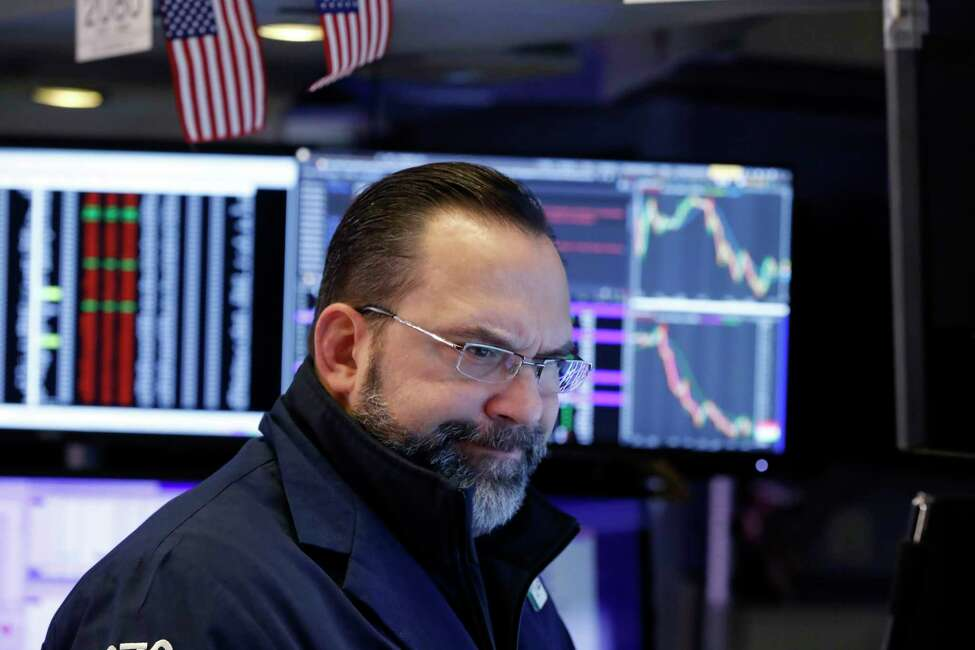 Specialist Anthony Matesic works on the floor of the New York Stock Exchange, Monday, Jan. 27, 2020. Stock tumbled at the open on Wall Street following a sell-off in markets in Europe and Japan as investors grow more concerned about the potential economic impact of an outbreak of a deadly coronavirus. (AP Photo/Richard Drew)