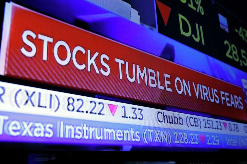 A television screen headlines trading on the floor of the New York Stock Exchange, Monday, Jan. 27, 2020. Stock tumbled at the open on Wall Street following a sell-off in markets in Europe and Japan as investors grow more concerned about the potential economic impact of an outbreak of a deadly coronavirus. (AP Photo/Richard Drew)
