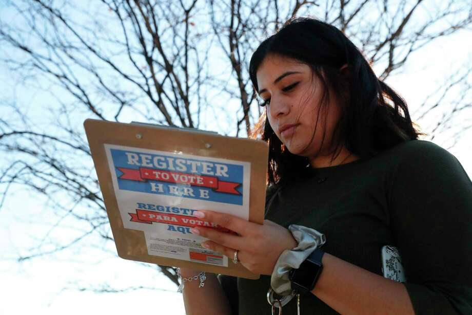 Karina Shumate, 21, a college student, fills out a voter registration form in Richardson on Jan. 18. A reader is hopeful Texas will see a two-party government once again. Photo: LM Otero /Associated Press / Copyright 2020 The Associated Press. All rights reserved.