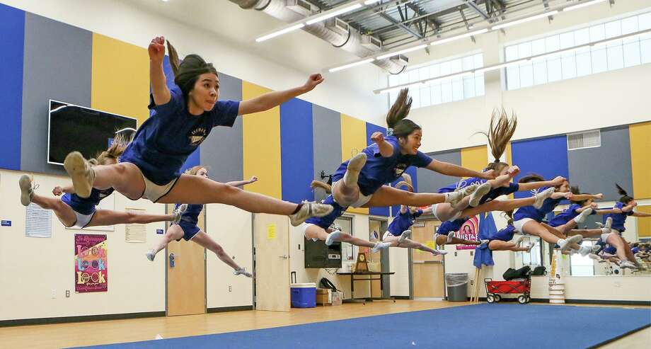 Isabel Marquez, front left, and her fellow Clemens varsity cheerleaders practice a toe touch during a cheer class at the school on Friday. The Clemens cheer team took first place overall in 6A Division II and also captured first place in the band chant category at the recent UIL Spirit State Championship in Fort Worth this month. Photo: Marvin Pfeiffer /Staff Photographer / **MANDATORY CREDIT FOR PHOTOG AND SAN ANTONIO EXPRESS-NEWS/NO SALES/MAGS OUT/TV