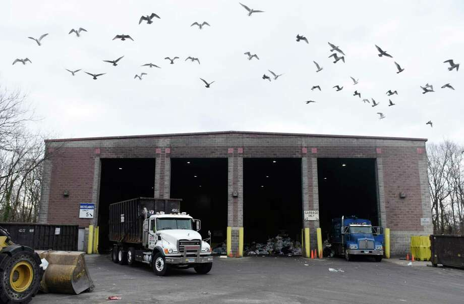A flock of seagulls flies away as trucks dump trash in the commercial dumping bay at the Holly Hill Transfer Station in Greenwich, Conn. Monday, Jan. 27, 2020. Photo: Tyler Sizemore / Hearst Connecticut Media / Greenwich Time