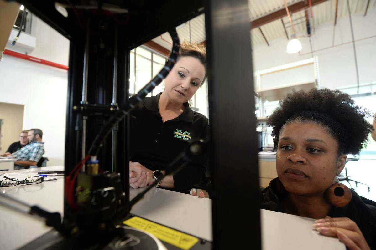 BISD STEM coordinator Marinette Parkerson (right) works with East Chambers science teacher Denise Pattison while learning to operate a 3-D printer as part of a STEM seminar for area teachers hosted by Lamar University at the Science & Technology Building Thursday. The day-long session offered science teachers of several disciplines with instructional ideas in addition to the 3-D printing segment. Each school was given a portable 3-D printer and related materials to take back for use in the classroom. Photo taken Thursday, Jan. 16, 2020 Kim Brent/The Enterprise