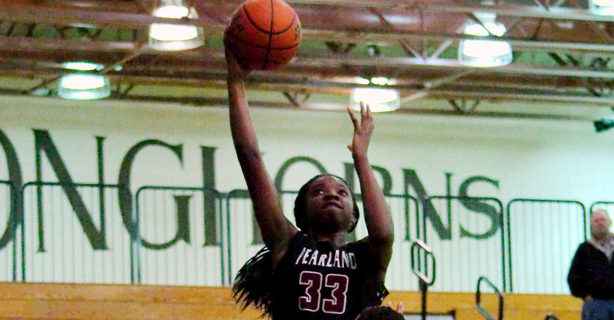Pearland's Deyona Gaston (33) puts up a shot over Clear Lake's Dominic Smauldon (11) Tuesday, Feb. 14 at Dobie High School.