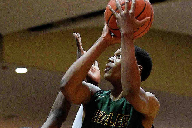 Klein Forest's Daylan Hamilton, right, drives to the basket as Eisenhower 's Ja'Mere Redus defends during the first half of a 6A quarterfinal high school basketball game, Tuesday, Feb. 26, 2019, in Houston.