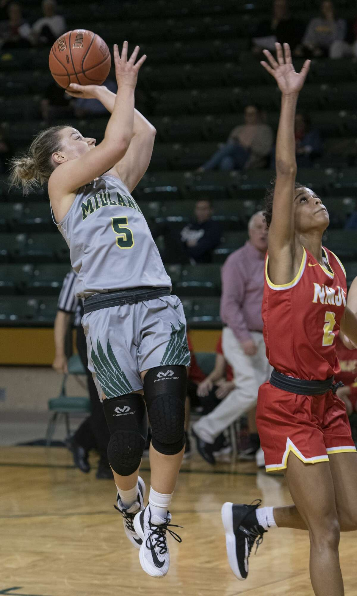 Midland College's Grace Beasley pulls up for a shot as New Mexico Junior College's Amaya Lewis tries to defend 01/27/20 at the Chaparral Center. Tim Fischer/Reporter-Telegram
