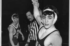 Scotia High School, New York - Bethlehem wrestler Chris Saba Undated (right) has hand raised after pinning Bob Kennen of Guilderland. January 28, 1988 (John Carl D'Annibale/Times Union Archive)