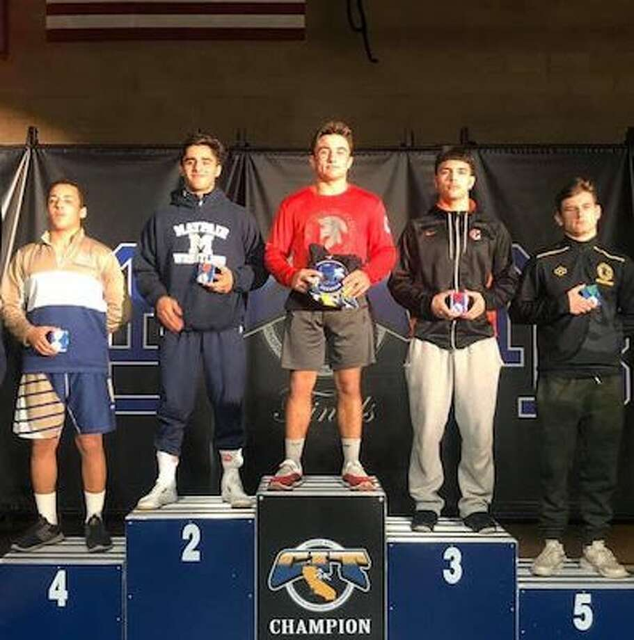 SportStar of the Week, returning state champion JT Stinson (red jersey) bumped up a weight class for the prestigious 81-team CIT Invitational. Photo: SportStars Magazine