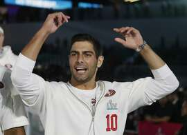 San Francisco 49ers' Jimmy Garoppolo arrives for Opening Night for the NFL Super Bowl 54 football game Monday, Jan. 27, 2020, at Marlins Park in Miami. (AP Photo/Chris Carlson)